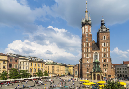 assumed: KRAKOW, POLAND - MAY 26, 2014: Mariacki church, Church of Our Lady Assumed into Heaven, a brick gothic church adjacent to the Main Market Square in Krakow, Poland. Editorial