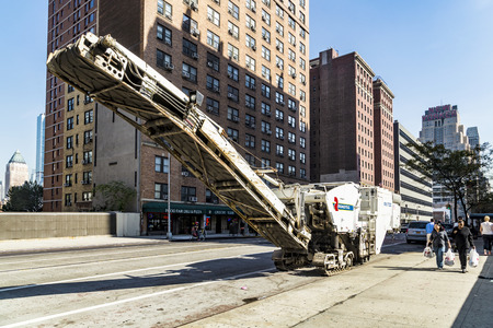 kw: NEW YORK, USA - OCT 21, 2015: street view with people and Roadtec street machine in New York City, USA. The Half- lane Cold Planer is featured with a 563 kw engine.