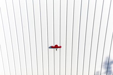 garage: locked door at a parking garage with red handle