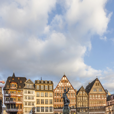 roemerberg: FRANKFURT, GERMAY - FEB 22, 2015: statue Lady Justice with sword and scale stands in front of half timbered houses at the Roemerberg in Frankfurt. The Roemeberg is the central place in Frankfurt.