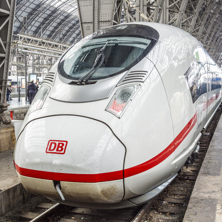 frequented: FRANKFURT, GERMANY - FEB 24, 2015: ICE train in Frankfurt central station in Frankfurt, Germany. With about 350.000 passengers per day its the most frequented railway station in Germany. Editorial