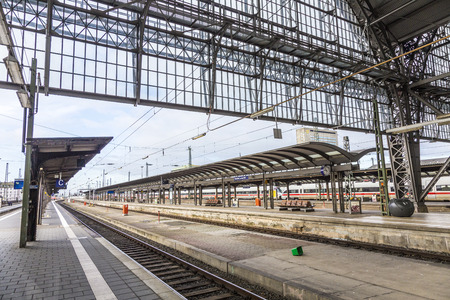 frequented: FRANKFURT, GERMANY - FEB 24, 2015: Inside the Frankfurt central station in Frankfurt, Germany. With about 350.000 passengers per day its the most frequented railway station in Germany.