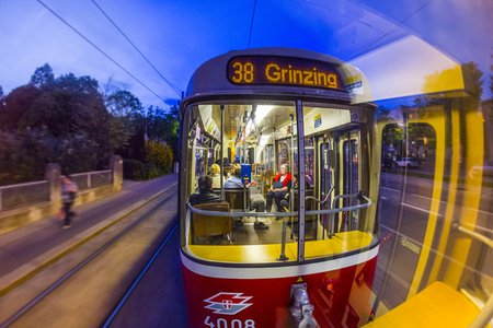 extensive: VIENNA, AUSTRIA - APR 25, 2015: Old fashioned tram by a night ride in Vienna, Austria. Vienna has an extensive train and bus network.
