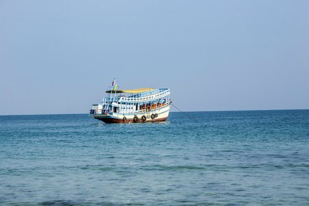 KOH SAMET, THAILAND - DEC 31, 2009: old wooden ferry boat brings tourists to the small island of Koh Samet in Thailand.