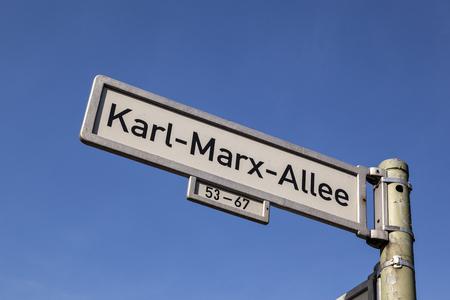 realist: street sign Karl Marx Allee, Berlin, Germany