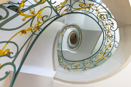 spiral staircase: public spiral staircase in an old house Stock Photo