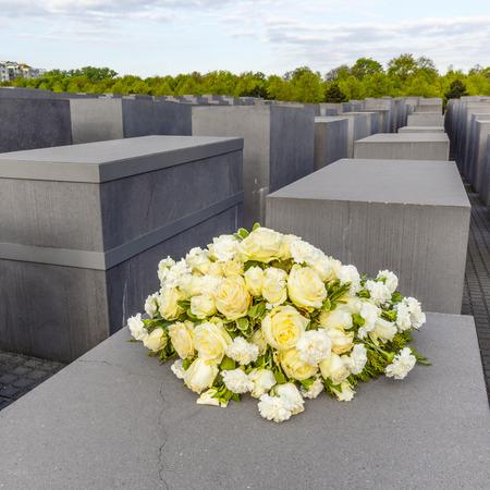 murdered: BERLIN, GERMANY - MAY 3, 2015: Holocaust Memorial on Berlin, varios gray cubes to remember murdered people