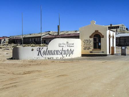kolmannskuppe: KOLMANSKOP, NAMIBIA - AUG 13, 2014: Ghost town Kolmanskop in the Namibia desert. The former german town was left with end of german colonialism end of world war 2.