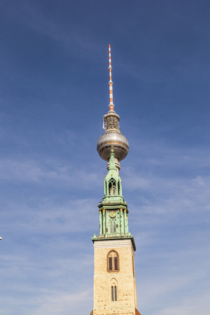 marys: View of Berlin TV Tower, know as The Fernsehturm, and St. Marys Church, known as the Marienkirche from Alexanderplatz.