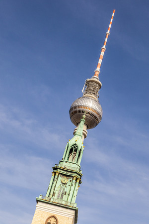 st german: View of Berlin TV Tower, know as The Fernsehturm, and St. Marys Church, known as the Marienkirche from Alexanderplatz.
