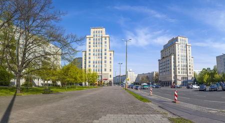 east berlin: BERLIN, GERMANY - MAY 1, 2015: Karl-Marx-Allee, a monumental socialist boulevard of the former East Berlin in Berlin, Germany.