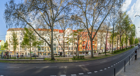 locality: BERLIN, GERMANY - MAY 1, 2015: people at Warschauer Strasse go to streetcar station. Warschauer Straße is a street in the Friedrichshain locality of central Berlin. Editorial