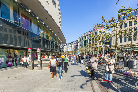 paveway: FRANKFURT, GERMANY - MAY 6, 2016: people walk along the Zeil in Midday in Frankfurt, Germany. Since the 19th century it is of the most famous and busiest shopping streets in Germany. Editorial