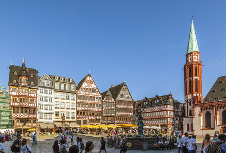 roemerberg: FRANKFURT, GERMANY - MAY 6, 2016: people at Roemerberg, a row of half-timbered houses at the east side square known as the Ostzeil. The Fountain of Justice in the middle.