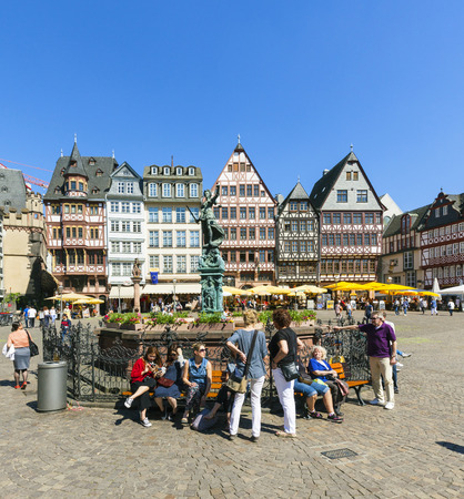 old town guildhall: FRANKFURT, GERMANY - MAY 8, 2016: people visit Romerberg (Romerplatz) with old buildings  in Frankfurt. In the center stands the fountain of Justice, a symbol of fairness and law. Editorial