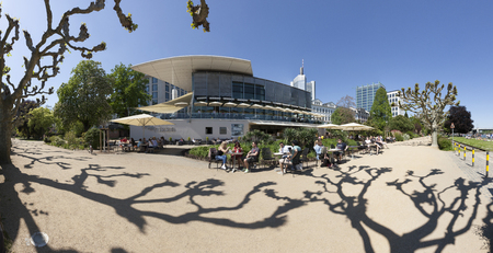 river main: FRANKFURT, GERMANY - MAY 8, 2016: people relax at the bank of river Main. This area is called Nizza and was build in 1860 by Sebastian Rinz. Plants of mediterranean climate grow in this area. Editorial