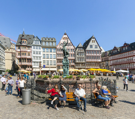 roemerberg: FRANKFURT, GERMANY - MAY 8, 2016: people visit Romerberg (Romerplatz) with old buildings  in Frankfurt. In the center stands the fountain of Justice, a symbol of fairness and law. Editorial