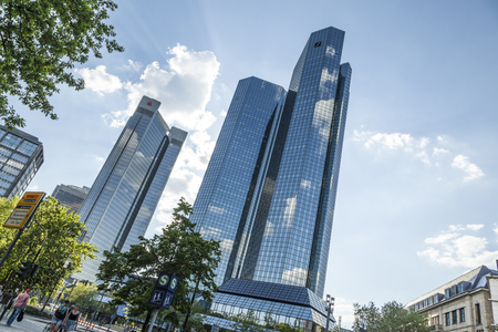 frankfurt stock exchange: FRANKFURT AM MAIN, GERMANY - MAY 7, 2016: Bottom view of 155 meter high Deutsche Bank Twin Towers in the central business district of Frankfurt, the largest financial center in Europe. Editorial
