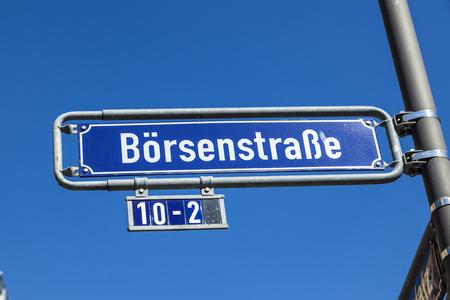 frankfurt stock exchange: street name stock exchange street under blue sky in frankfurt