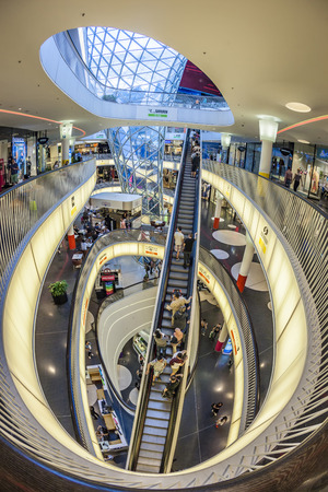 roth: FRANKFURT, GERMANY - MAY 7, 2016: people enjoy famous modern MyZeil mall. Myzeil was opened in 2009 by mayor Petra Roth.