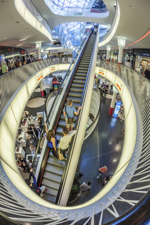 view of a staircase in a shop: FRANKFURT, GERMANY - MAY 7, 2016: people enjoy famous modern MyZeil mall. Myzeil was opened in 2009 by mayor Petra Roth.