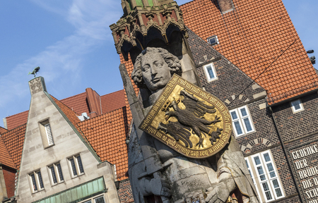 architectural tradition: BREMEN, GERMANY - MAY 12, 2016: Medieval statue of Knight Roland in front of the town hall at Bremen. The Bremen Roland is a statue of Roland, erected in 1404.