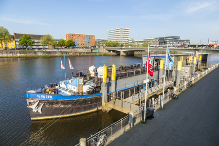 ms: BREMEN, GERMANY - MAY 12, 2016: River Weser with ship MS Ruegen anchored at river bank. The MS Ruegen serves as theater ship nowadays organized by Knut Schakinnis. Editorial