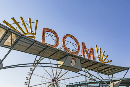 reeperbahn: HAMBURG, GERMANY - JULY 25, 2012: famous neon sign Dom in Hamburg. The dom is a large fair in Hamburg and attracts more than 10 million people yearly. Editorial