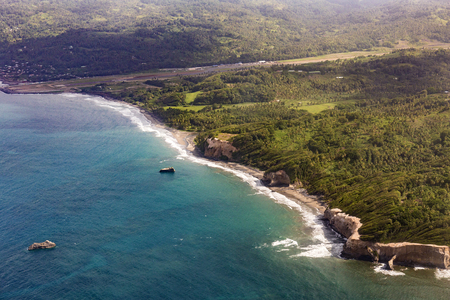 salinity: aerial of green jungle, coast and ocean in Dominica