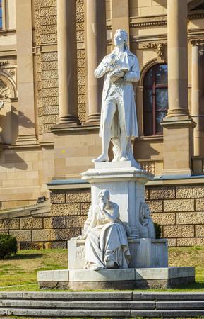 friedrich: WIESBADEN, GERMANY - AUG 19, 2012: statues at the Hessisches Staatstheater Wiesbaden in Wiesbaden. The statue shows author Friedrich Schiller. Editorial
