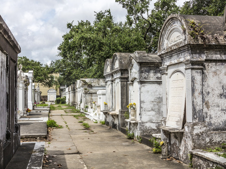 grave site: NEW ORLEANS, USA - JULY 16, 2013: Grave site at the Saint Louis Cemetery No 1. This Lafayette cemetery is the most famous in New Orleans. Editorial