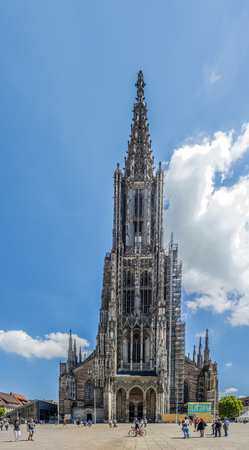 minster: ULM, GERMANY - MAY 26, 2016: people visit Ulm Minster  in Ulm, Germany. Ulm Minster is the tallest church in the world with height 161.5 metres (530 ft).