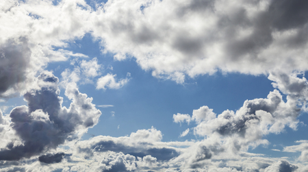 cumulus: White Cumulus Clouds And Grey Storm Clouds Gathering On Blue Sky