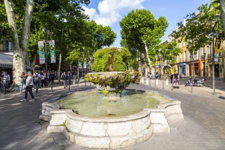 still lifes: AIX EN PROVENCE, FRANCE - JUNE 3, 2016: people at cours Mirabeau at  nine cannon fontain in Aix en Provence, The sculptures are not visible because of the moss vegetation. Editorial