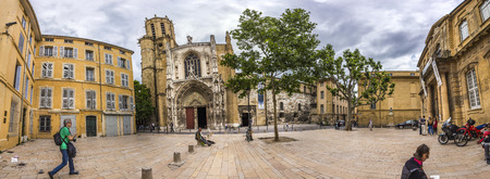 cathedrale: AIX EN PROVENCE, FRANCE - JULY 8, 2015: famous church Cathedrale Sainte Sauveur in Aix-en-Provence, France. People walk at the forecourt.