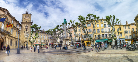 17th century: AIX EN PROVENCE, FRANCE - JULY 8, 2015: people enjoy sitting at the central place in Aix en  provence at town hall square. The townhall was built in the 17th century. Editorial