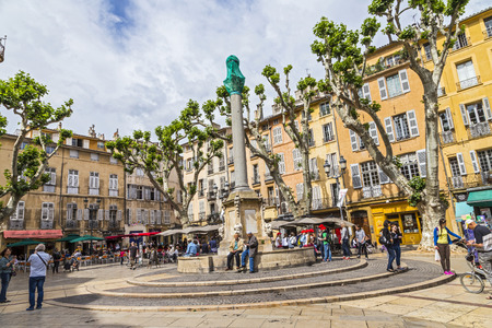 townhall: AIX EN PROVENCE, FRANCE - JULY 8, 2015: people enjoy sitting at the central place in Aix en  provence at town hall square. The townhall was built in the 17th century. Editorial