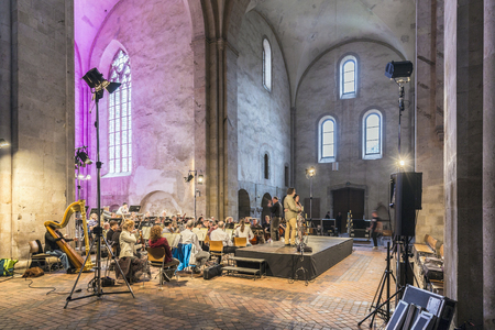 verdi: EBERBACH, GERMANY - JUNE 12, 2016: singer John Osborne and Lynette Tapia examin with the orchestra for tonights performance of famous arias of classical composer in the Basilika of cloister Eberbach.