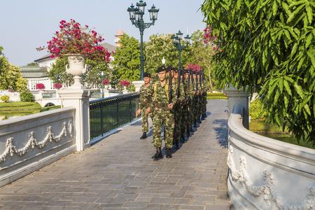 AJUTTHAYA, THAILAND - DEC 24, 2009: Guards are changing at Bang Pa-In Palace near Ajutthaya, Thailand (Summer Palace of the Thai king) Editorial