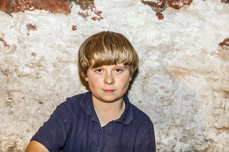boy 12 year old: portrait of a cute young boy with old brick background