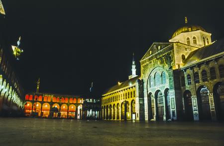 damascus: DAMAESCUS, SYRIA - NOV 23, 1996:  The Omayyad Mosque in Damascus, Syria is perfectly illuminated at night. Editorial