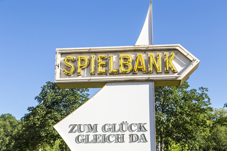 gambler: BAD HOMBURG, GERMANY - JUNE 27, 2016: arrow with sign to Spielbank in Bad Homburg, Germany. The Spielbank was opened in 1841 and is one of the oldest in Europe. Editorial
