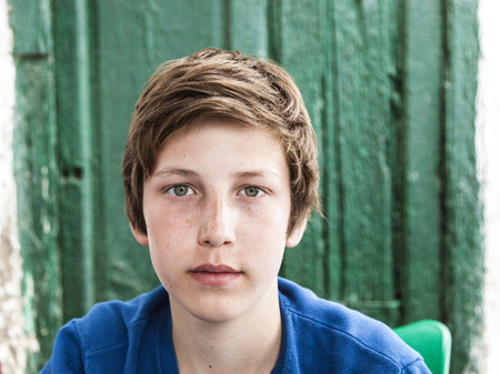 critical thinking: outdoor portrait of happy young teenage boy