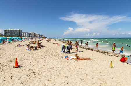 south beach: MIAMI, USA - AUG 1, 2013: people enjoy the hot summer day at south beach in Miami, USA. South beach is the famous beach at art deco district neaqr ocean drive street. Editorial