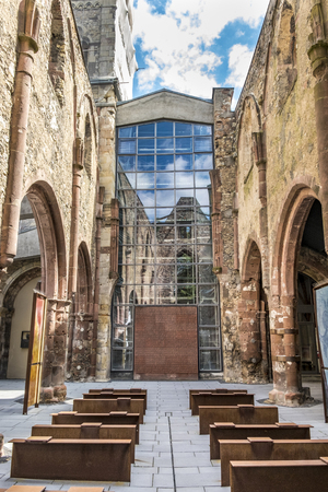transformed: MAINZ, GERMANY - JULY 15, 2016: old destroyed church St.  Christoph in the city of Mainz. in 1963 the ruin was transformed to am memorial against war.