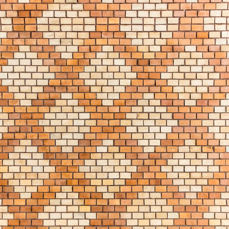 rhomb: brick wall decorated with geometric rhomb motifs