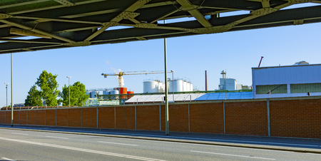 industry park: industry park from roadside with railway bridge Stock Photo