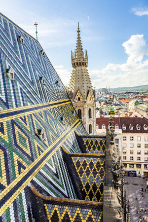 saint stephen cathedral: VIENNA, AUSTRIA - APR 27, 2015: north tower view and roof tiles of Stephansdom, St. Stephens Cathedral, Vienna Editorial