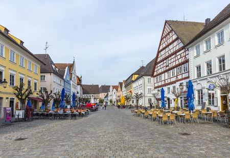 market place: GUENSBURG, GERMANY - APR 29, 2015: people at the old market place in Guensburg, Germany with half timbered and old historic houses.