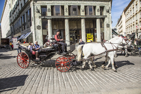 licence: VIENNA, AUSTRIA - APR 27, 2015: Traditional horse riding in a Fiaker through the city center in Vienna, Austria. The numer of horse riders is limited and they have a special licence. Editorial